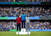 Award ceremony, athletes on podium at a stadium