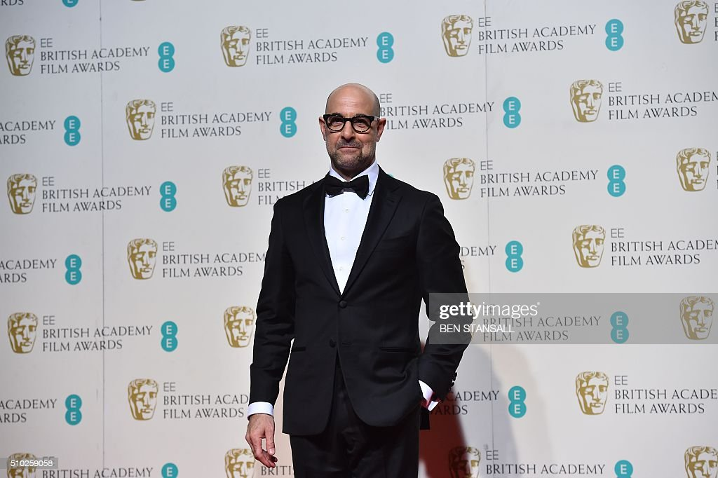 Award presenter British actor and director Stanley Tucci poses in the winners area at the BAFTA British Academy Film Awards at the Royal Opera House in London on February 14, 2016. AFP / BEN STANSALL / AFP / BEN STANSALL
