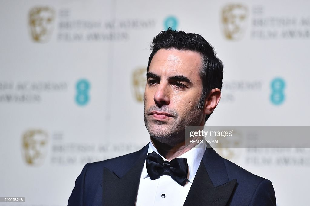 Award presenter British actor Sacha Baron Cohen poses in the winners area at the BAFTA British Academy Film Awards at the Royal Opera House in London on February 14, 2016. AFP / BEN STANSALL / AFP / BEN STANSALL
