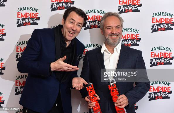 Award presenter Jonathan Ross poses with Sam Mendes with his awards in the winners room at the Jameson Empire Awards 2016 at The Grosvenor House...