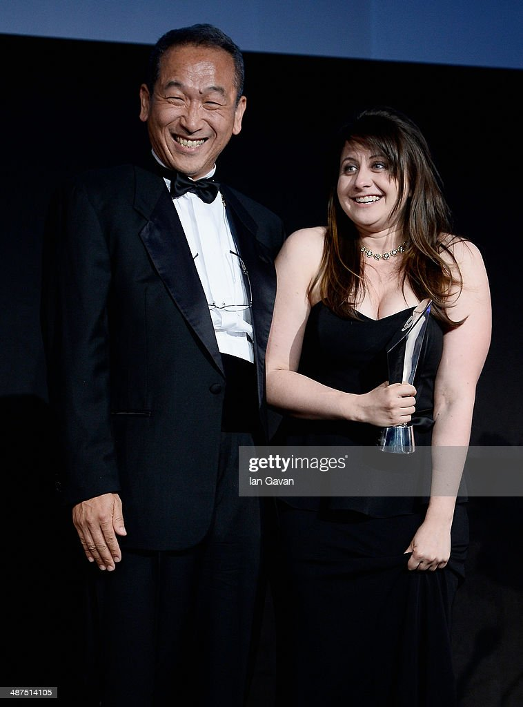 Award presenter Masaru Tamagawa, President Sony Europe and winner of the L'Iris d'Or award Sara Naomi Lewkowicz on stage at the 2014 Sony World Photography awards (SWPA) at the London Hilton on April 30, 2014 in London, England.