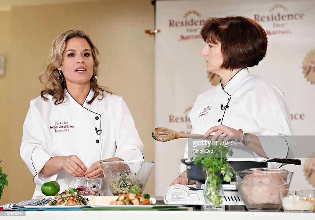 Award recipient, chef and lifestyle entrepreneur <a gi-track='captionPersonalityLinkClicked' href=/galleries/search?phrase=Cat+Cora&family=editorial&specificpeople=4166787 ng-click='$event.stopPropagation()'>Cat Cora</a> conducts a cooking demonstration with Residence Inn by Marriott VP and Global Brand Manager, Diane Mayer at the 2013 Resident Mom of the Year event at Residence Inn by Marriott on May 3, 2013 in New York City.
