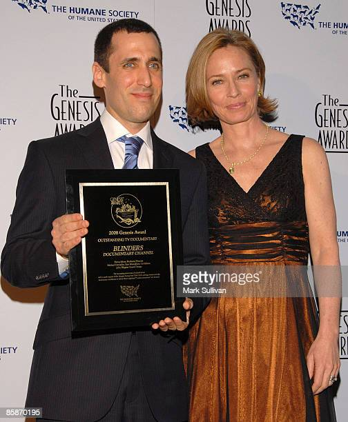 Award recipient Donny Moss and presenter Susanna Thompson attend the press room for the 23rd Genesis Awards at International Ballroom at The Beverly...