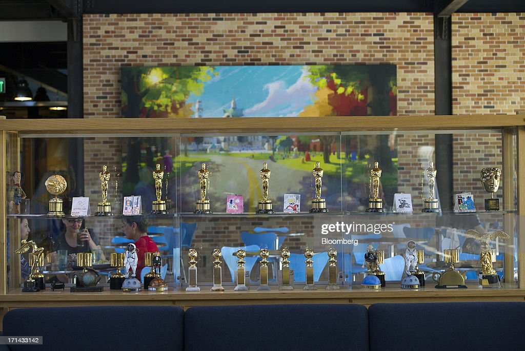 Award statues are displayed inside the lobby and cafeteria area at the Pixar Animation Studios headquarters in Emeryville, California, U.S., on Friday, June 21, 2013. Walt Disney Co.s Pixar animation 'Monsters University' took first place at U.S. and Canadian theaters this past weekend with $82 million in ticket sales, overcoming Brad Pitts zombie apocalypse tale 'World War Z,' which was second with $66 million. Photographer: David Paul Morris/Bloomberg via Getty Images