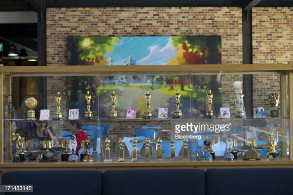 Award statues are displayed inside the lobby and cafeteria area at the Pixar Animation Studios headquarters in Emeryville California US on Friday...
