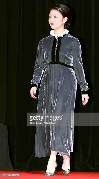ARIGATO Award winner actress Mitsuki Takahata is seen on stage during the award ceremony of the Tokyo International Film Festival at the EX Theater...