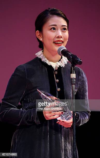 ARIGATO Award winner actress Mitsuki Takahata speaks on stage during the award ceremony of the Tokyo International Film Festival at the EX Theater...