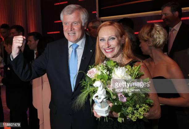 Award winner Andrea Sawatzki and Bavaria's state governor Horst Seehofer pose during the Bavarian TV Award 2011 'Der Blaue Panther' at...