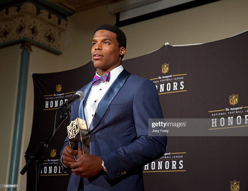 Award winner Carolina Panthers quarterback <a gi-track='captionPersonalityLinkClicked' href=/galleries/search?phrase=Cam+Newton+-+American+Football+Quarterback&family=editorial&specificpeople=4516761 ng-click='$event.stopPropagation()'>Cam Newton</a> talks to the press after winning at the 2012 NFL Honors at the Murat Theatre on February 4, 2012 in Indianapolis, Indiana.