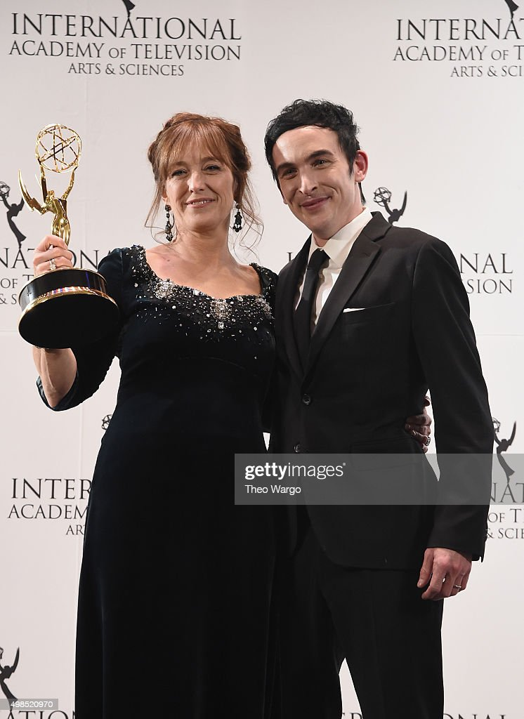 Award Winner for Best Performance By An Actress Anneke von der Lippe (as Helen Sikkeland for Qevitne (Eyewitness) celebrates with Presenter Robin Lord Taylor at 43rd International Emmy Awards at New York Hilton on November 23, 2015 in New York City.