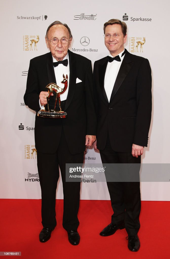 Award winner <a gi-track='captionPersonalityLinkClicked' href=/galleries/search?phrase=Hans-Dietrich+Genscher&family=editorial&specificpeople=206441 ng-click='$event.stopPropagation()'>Hans-Dietrich Genscher</a> and Guido Westerwlle pose with the Bambi award at the Bambi 2010 Award Winners Board at Filmpark Babelsberg on November 11, 2010 in Potsdam, Germany.
