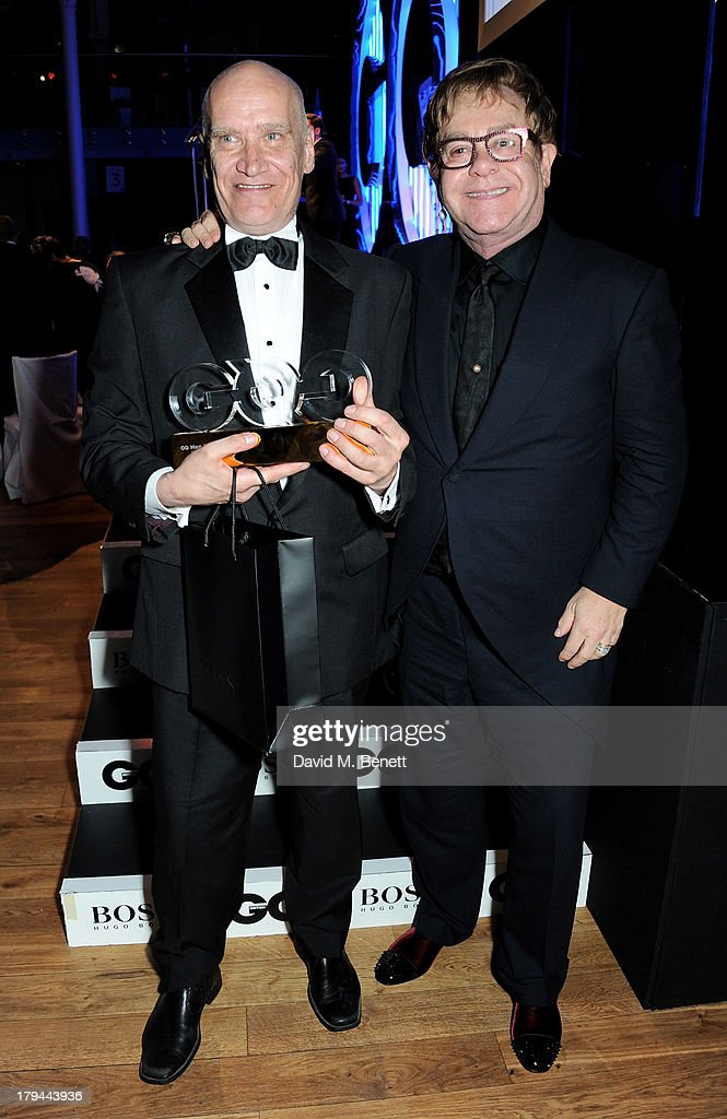 Award winner Wilko Johnson (L) and Sir Elton John attend the GQ Men of the Year awards at The Royal Opera House on September 3, 2013 in London, England.
