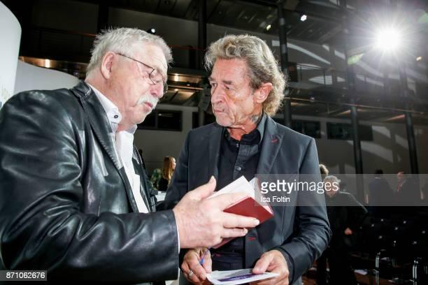 Award winner Wolf Biermann and German singer Peter Maffay during the VDZ Publishers' Night at Deutsche Telekom's representative office on November 6...