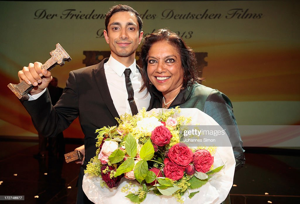 Award winners British actor with Pakistan origins Riz Ahmed (L) and Indian director <a gi-track='captionPersonalityLinkClicked' href=/galleries/search?phrase=Mira+Nair&family=editorial&specificpeople=214181 ng-click='$event.stopPropagation()'>Mira Nair</a> pose with the award trophy after the Bernhard Wicki Award ceremony at Munich film festival on July 4, 2013 in Munich, Germany.