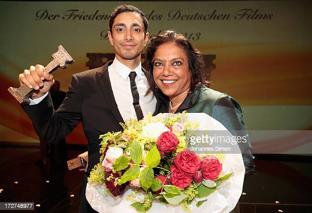 Award winners British actor with Pakistan origins Riz Ahmed and Indian director Mira Nair pose with the award trophy after the Bernhard Wicki Award...