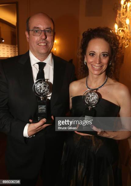 Award winners Christopher Ashley and Rebecca Taichman pose in the press room during the 2017 Tony Awards at 3 West Club on June 11 2017 in New York...