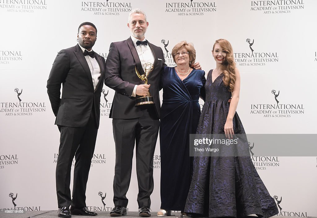 Award Winners for Non-Scripted Entertainment for '50 Ways To Kill Your Mammy' Baz Ashmawy, Executive Producer and Nancy Ashmawy, Principal Cast celebrate with Presenters Holly Taylor (R) and Joel Benoliel (L) at 43rd International Emmy Awards at New York Hilton on November 23, 2015 in New York City.