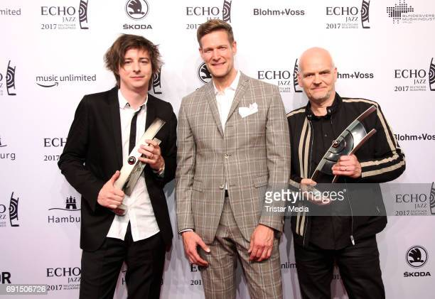 Award winners Michael Wollny and Lars Danielsson with Goetz Buehler during the Echo Jazz 2017 on June 1 2017 in Hamburg Germany