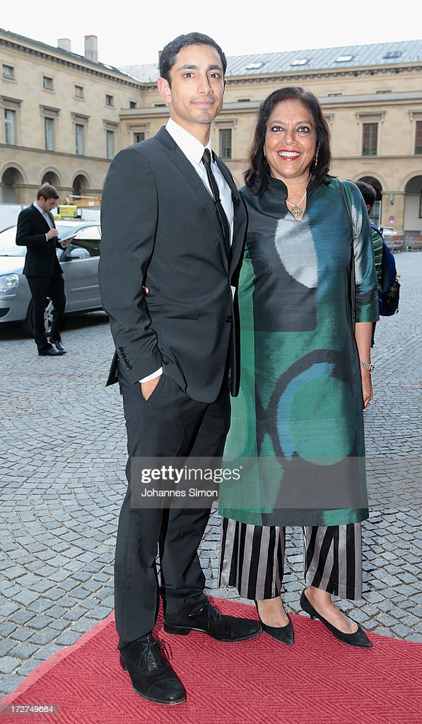 Award winners Riz Ahmed (L) and <a gi-track='captionPersonalityLinkClicked' href=/galleries/search?phrase=Mira+Nair&family=editorial&specificpeople=214181 ng-click='$event.stopPropagation()'>Mira Nair</a> arrive for the Bernhard Wicki Award ceremony at Munich Film Fesitval on July 4, 2013 in Munich, Germany.