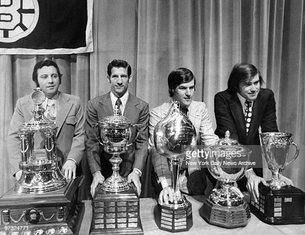 NHL award winners show their trophies Hawks' Tony Esposito Vezina award Rangers' Jean Ratelle Lady Byng award Bruins' Bobby Orr Hart and Norris award...
