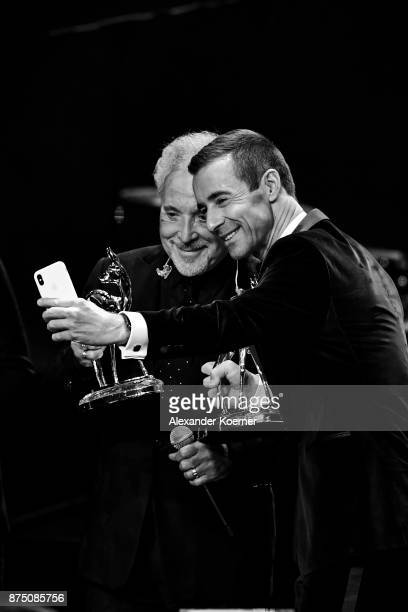 Award Winners Tom Jones and Kai Pflaume take a selfie during the Bambi Awards 2017 show at Stage Theater on November 16 2017 in Berlin Germany