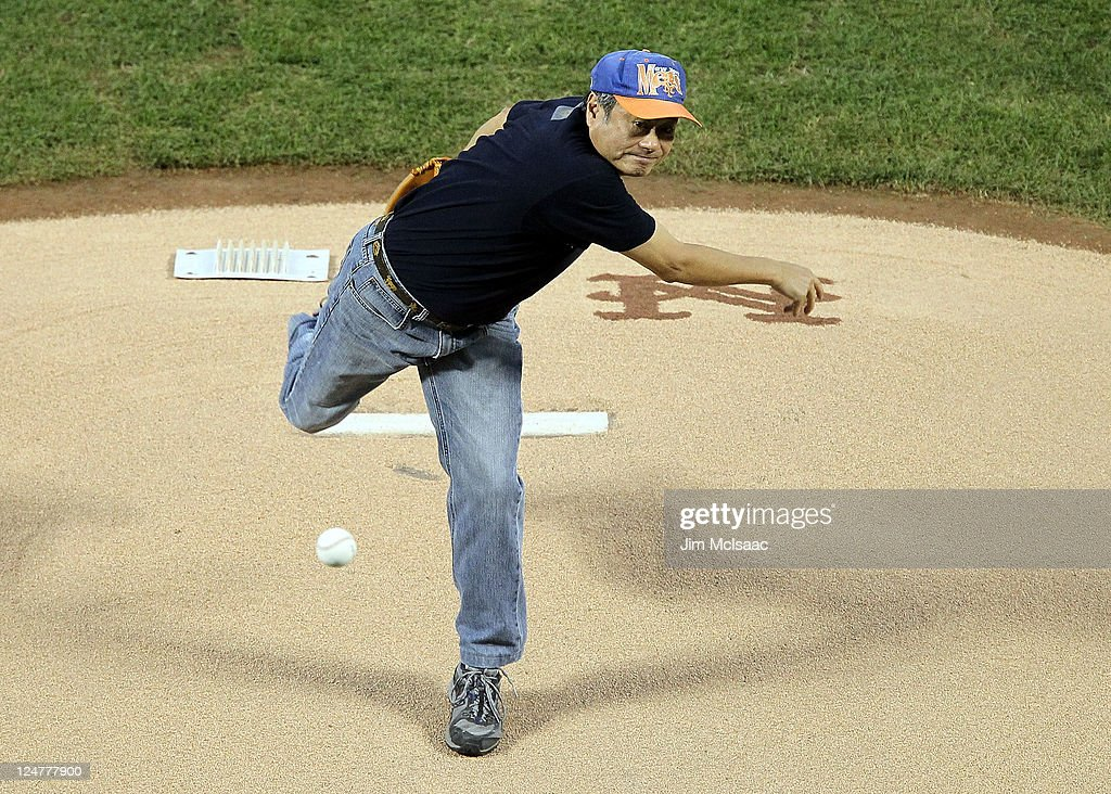 Award winning film director <a gi-track='captionPersonalityLinkClicked' href=/galleries/search?phrase=Ang+Lee&family=editorial&specificpeople=215104 ng-click='$event.stopPropagation()'>Ang Lee</a> throws out the ceremonial first pitch before the game between the New York Mets and Washington Nationals at Citi Field on September 12, 2011 in the Flushing neighborhood of the Queens borough of New York City.