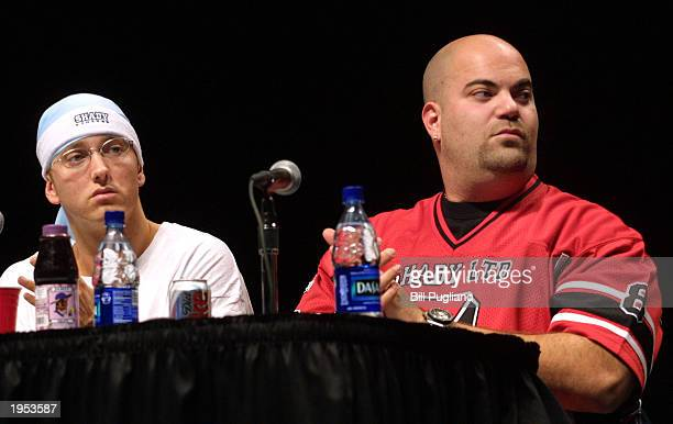 Award winning hiphop artist Eminem sits next to his manager Paul Rosenbergat while attending the Detroit Hip Hop Summit April 26 2003 in Detroit...