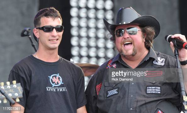 Awarded 2 Purple Hearts 'Wounded Warrior' Patrick Brown joins Colt Ford on stage and performs during the First Annual Rapids Jam Music Festival 2011...