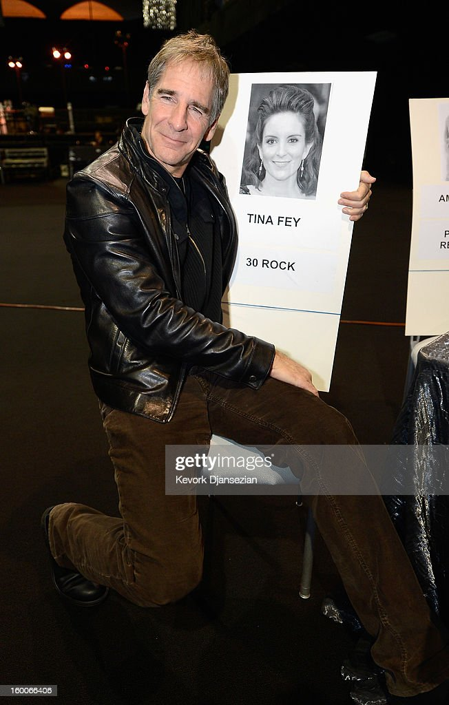 Awards Committee member actor <a gi-track='captionPersonalityLinkClicked' href=/galleries/search?phrase=Scott+Bakula&family=editorial&specificpeople=217589 ng-click='$event.stopPropagation()'>Scott Bakula</a> poses next to the place card of actress <a gi-track='captionPersonalityLinkClicked' href=/galleries/search?phrase=Tina+Fey&family=editorial&specificpeople=206753 ng-click='$event.stopPropagation()'>Tina Fey</a> during the 19th Annual Screen Actor Guild Awards ceremony behind the scenes event at The Shrine Auditorium on January 25, 2013 in Los Angeles, California.