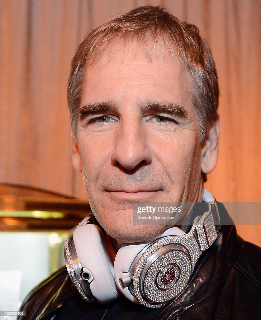 Awards Committee member actor <a gi-track='captionPersonalityLinkClicked' href=/galleries/search?phrase=Scott+Bakula&family=editorial&specificpeople=217589 ng-click='$event.stopPropagation()'>Scott Bakula</a> tries on Beats by Dre headphones created by Graff Diamonds, which are adorned with more than 114 carats in diamonds worth $1 million dollars during the 19th Annual Screen Actor Guild Awards ceremony behind the scenes event at The Shrine Auditorium on January 25, 2013 in Los Angeles, California.