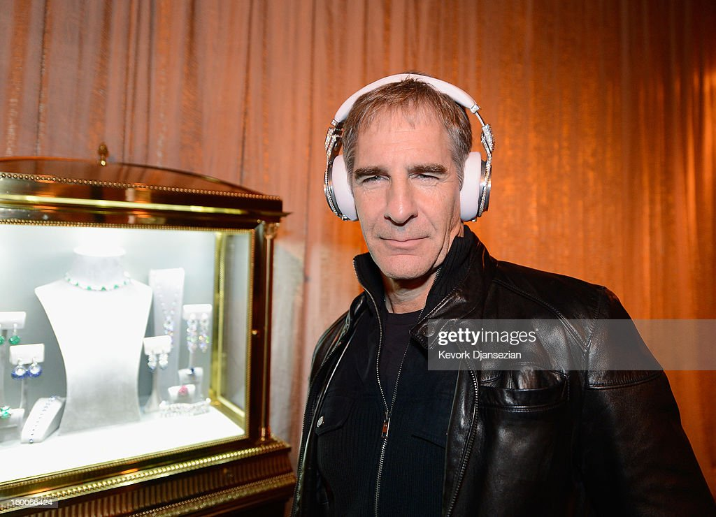 Awards Committee member actor Scott Bakula tries on Beats by Dre headphones created by Graff Diamonds, which are adorned with more than 114 carats in diamonds worth $1 million dollars during the 19th Annual Screen Actor Guild Awards ceremony behind the scenes event at The Shrine Auditorium on January 25, 2013 in Los Angeles, California.