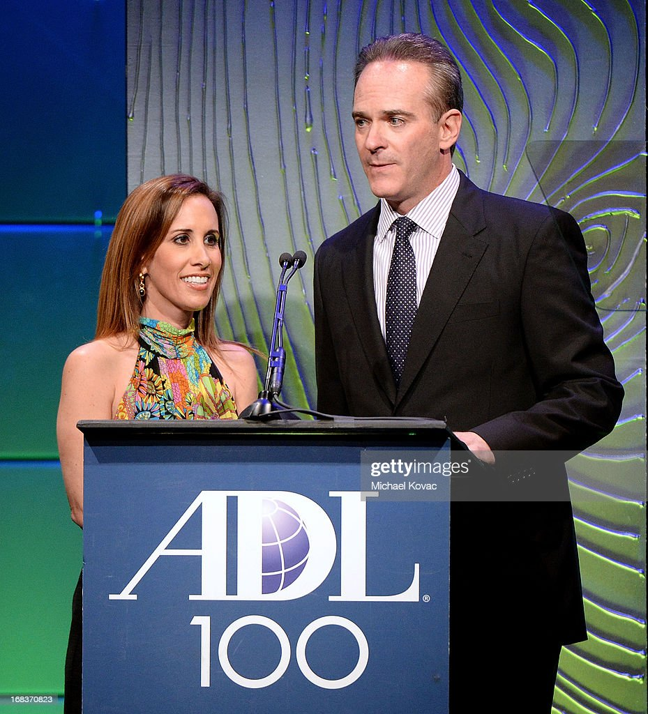 ADL Awards Dinner Chairs Stacey Garfinkel and Michael Garfinkel (R) present onstage at the Anti-Defamation League Centennial Entertainment Industry Awards Dinner Honoring Jeffrey Katzenberg at The Beverly Hilton Hotel on May 8, 2013 in Beverly Hills, California.