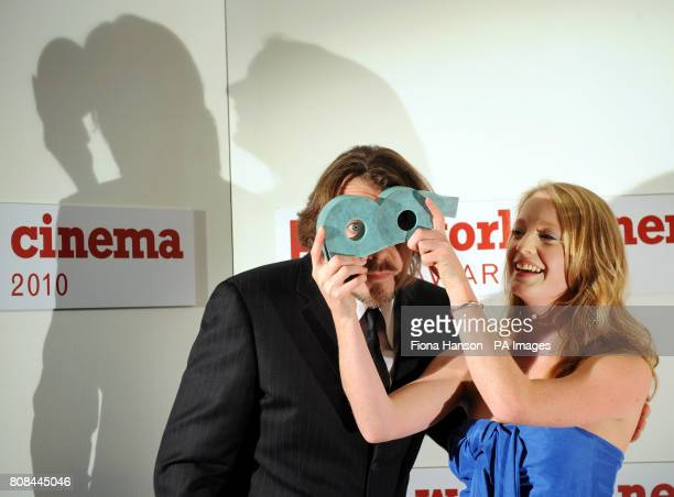 Awards presenter Jonathan Ross looks through the award given to actress Leonie Benesch who was awarded the BBC Four World Cinema Award 2010 for Best...