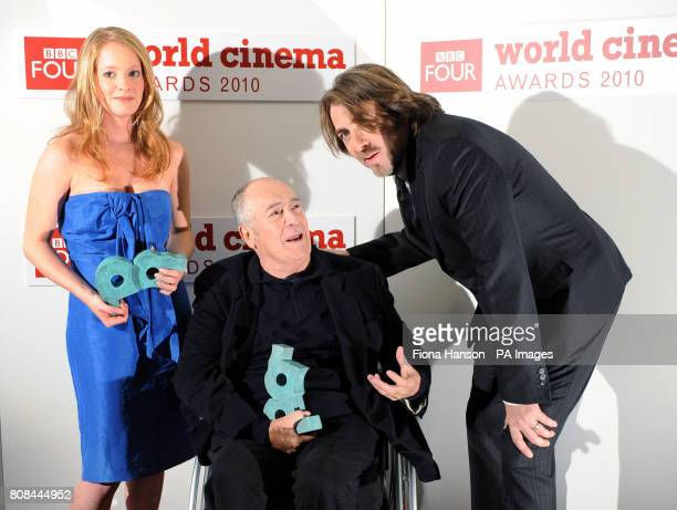 Awards presenter Jonathan Ross stands with film director Bernado Bertolucci centre who was awarded a Lifetime Achievement award and actress Leonie...