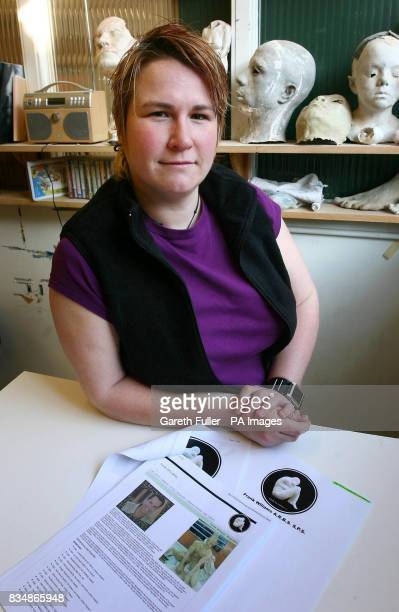 Awardwinning artist Eve Shepherd at her studio in Hove East Sussex with copies of web pages which show how a con artist is using her identity to dupe...