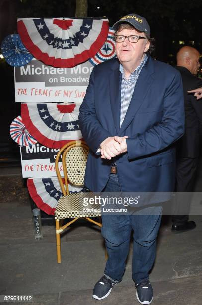 Awardwinning filmmaker Michael Moore celebrates his Broadway Opening Night in 'The Terms of My Surrender' at an after party at Bryant Park Grill on...