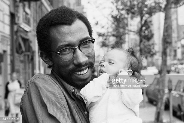 Awardwinning writer distinguished academic and teacher photographer and musician Julius Lester poses for a portrait with his daughter Jody Simone on...