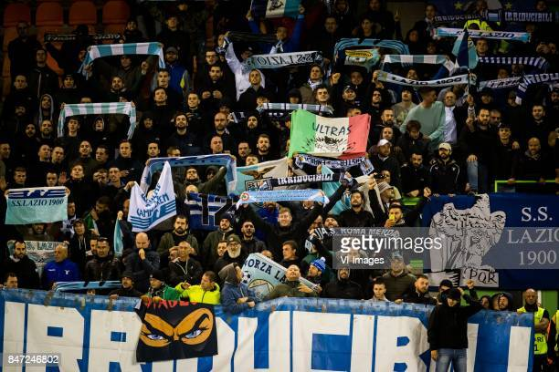 away fans of Lazio Roma with scarfs banners and flags during the UEFA Europa League group K match between Vitesse Arnhem and Lazio Roma at Gelredome...