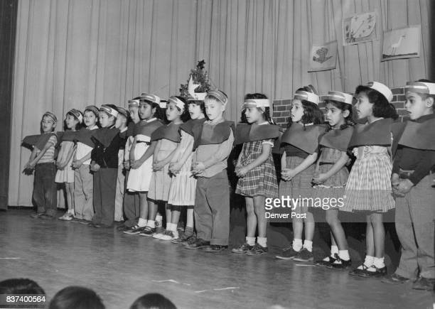 DEC 15 1954 DEC 17 1954 'Away in a manger' sing these first grade carolers in the Christmas program at Fairview school at 2715 W 11th Ave With the...