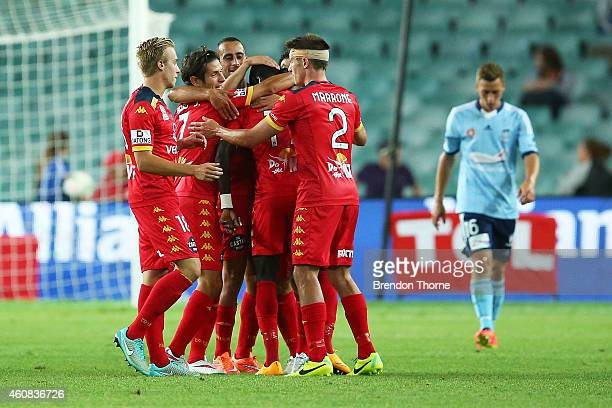 Awer Mabil of Adelaide celebrates with team mates after scoring a goal during the round 13 ALeague match between Sydney FC and Adelaide United at...