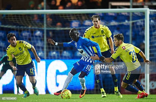 Awer Mabil of Esbjerg fB and Andrew Hjulsager of Brondby IF compete for the ball during the Danish Alka Superliga match between Esbjerg fB and...