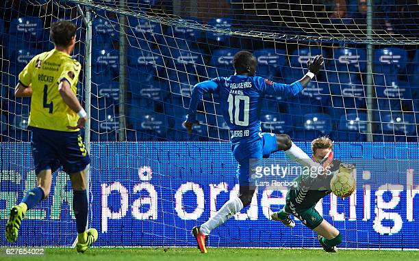 Awer Mabil of Esbjerg fB and Goalkeeper Frederik Ronnow of Brondby IF compete for the ball during the Danish Alka Superliga match between Esbjerg fB...