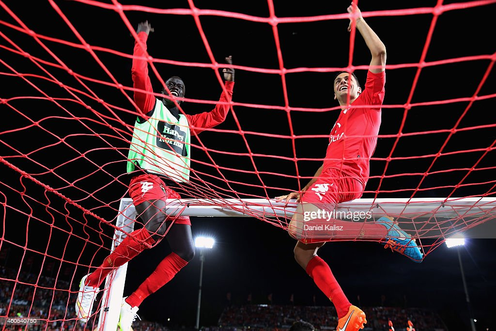 Awer Mabil (L) of United and Marcelo Carrusca of United react after the FFA Cup Final match between Adelaide United and Perth Glory at Coopers Stadium on December 16, 2014 in Adelaide, Australia.