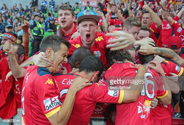 Awer Mabil of United celebrates with United supporters after scoring a goal during the round eight ALeague match between Melbourne Victory and...