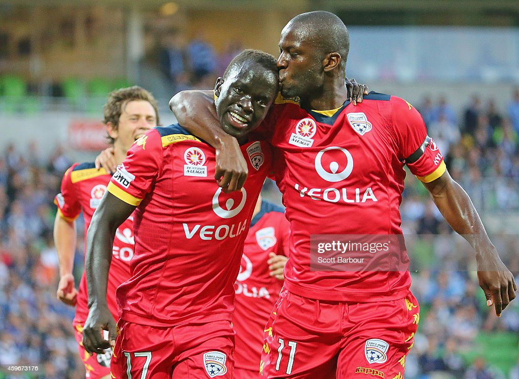 Awer Mabil of United is kissed by Bruce Djite after scoring a goal during the round eight ALeague match between Melbourne Victory and Adelaide United...