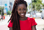Awesome african woman with dreadlocks  outdoor in city in summer