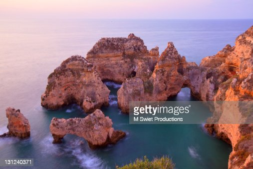 Awesome Rocky Cliff Formations At Sunrise Stock Photo
