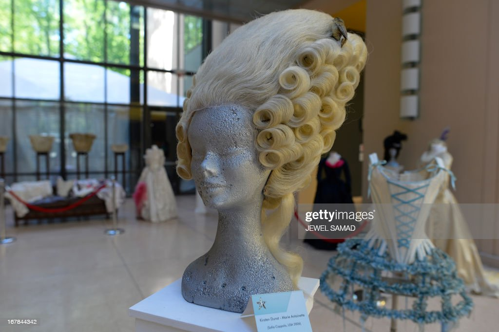 AWigs worn in the 2006 film Marie Antoniette, directed by Sofia Coppola are displayed during an exhibition at the Italian embassy in Washington, DC, on May 1, 2013. The exhibition, titled 'Star Wigs La Mano Italian Crea' is organized to give tribute to Italian cultural and historical heritage of creating a character in the film industry, showcased wigs and costumes used in historical films and actors such as Sofia Coppola's Marie Antoniette, Fellini's Casanova, Visconti's Angelica, Jane Fonda's Barbarella, Nicole Kidman's Moulin Rouge and Elizabeth Taylor's Cleopatra. AFP PHOTO/Jewel Samad
