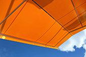 Modertn awning against a blue sky