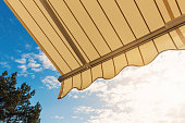 awning against blue sunny sky